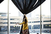 Austin, Texas - February 28, 2014:<br /> Maddie Hamilton pulls the drapes at the Long Center during the Texas Photo Roundup<br /> <br /> CREDIT: Matt Roth