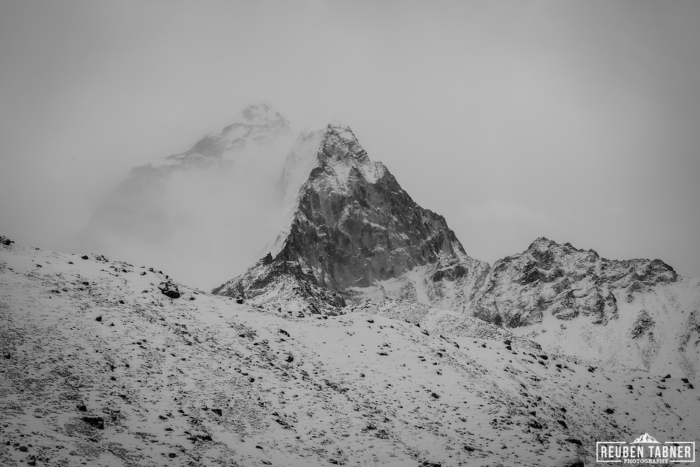 Ama Dablam is almost hidden from view by heavy snow fall.