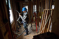 SAN RAMON, CA - DECEMBER 28:  Javier Ramires installs wiring on a new home development on December 28, 2007 in San Ramon, California. The Commerce Department reported December 28 that the sales of new homes in the US dropped to the lowest level in 12 years for the month of November.  (Photograph by David Paul Morris)
