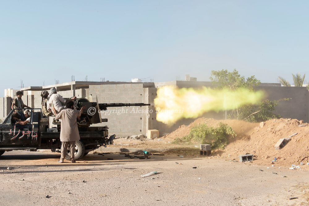 Libya: Libya's Government of National Accord's (GNA) fighter shoot with an heavy machine gun at ISIS positions in 700 neighbourhood in Sirte still under ISIS control. Alessio Romenzi