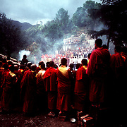 Surrounded by crimson robed Tibetan monks, the Dalai Lama performs a puja in Dharamsala,India.©1986 Ed Hille / Picturedesk.Net.ONE TIME USE ONLY