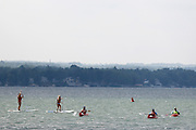 Kayakers and paddle boarders take to Canandaigua Lake on Sunday, July 27, 2014.