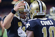 NEW ORLEANS, LA - NOVEMBER 13:  Drew Brees #9 congratulates Brandin Cooks #10 of the New Orleans Saints after catching a touchdown pass during a game against the Denver Broncos at Mercedes-Benz Superdome on November 13, 2016 in New Orleans, Louisiana.  The Broncos defeated the Saints 25-23.  (Photo by Wesley Hitt/Getty Images) *** Local Caption *** Drew Brees; Brandin Cooks