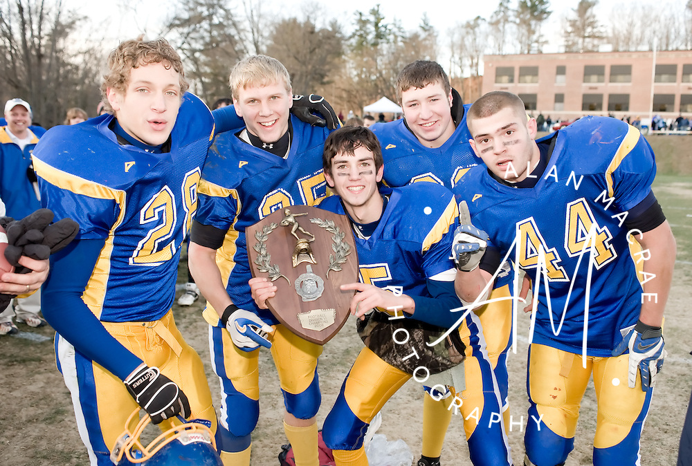 Franklin's captains pose with their NHIAA D VI first place plaque following Saturday's victory over Campbell.  (Alan MacRae/for the Citizen)