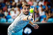 Grigor Dimitrov plays a backhand during the 2017 Australian Open at Melbourne Park, Melbourne, Victoria. 23/01/2017. Photo by Luke Hemer/Tennis Australia. Copyright Tennis Australia.