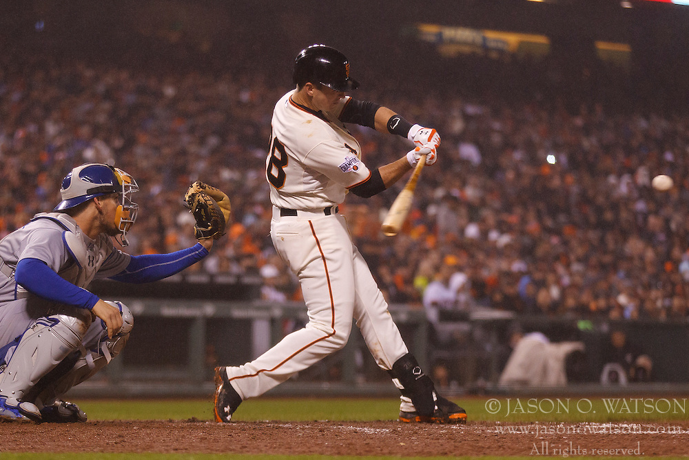 SAN FRANCISCO, CA - MAY 20:  Buster Posey #28 of the San Francisco Giants hits a two run home run against the Los Angeles Dodgers during the seventh inning at AT&T Park on May 20, 2015 in San Francisco, California.  (Photo by Jason O. Watson/Getty Images) *** Local Caption *** Buster Posey