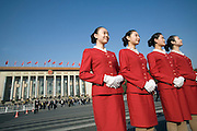 Hostesses stand in front of the Great Hall of People before the last session of the 17th Communist Party Congress in Beijing, China, on Sunday, Oct. 21, 2007.