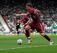 Edgaras Jankauskas took advantage of a Hibs defensive error to score the third goal for Hearts. Photo: Tom Ross.<br />