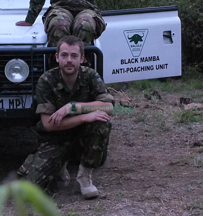 Dec. 7, 2014 - BALULE RESERVE, SOUTH AFRICA: Black Mamba Commander and former Royal Navy serviceman Russell Baker. LED BY BRITISH former military personnel these pictures show how courageous women anti-poachers train with guns in their battle to preserve Africa's endangered animals. Operating in the Kruger National Park's Balule Nature Reserve the 24-member strong all-female Black Mamba Anti-Poaching Unit patrols 50,000 hectares of bush to protect elephants and rhinos that are hunted as part of the estimated £12billion a year illegal world animal trade. These ladies, who as pictures show pose with weapons but also know how to party, are on the front line of a deadly war for the resources of their continent. Over the past year 1,000 wildlife rangers have been killed in Africa while protecting endangered wildlife. Black Mamba Commander and former Royal Navy serviceman Russell Baker (28) from Grimsby, UK explained exclusively how and why this South African special unit was established. (Credit Image: © Media Drum World/MediaDrumWorld/ZUMAPRESS.com)