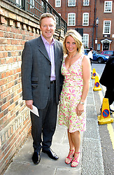 RORY & TESSA BREMNER at Sir David & Lady Carina Frost's annual summer party held in Carlyle Square, London on 6th July 2004.