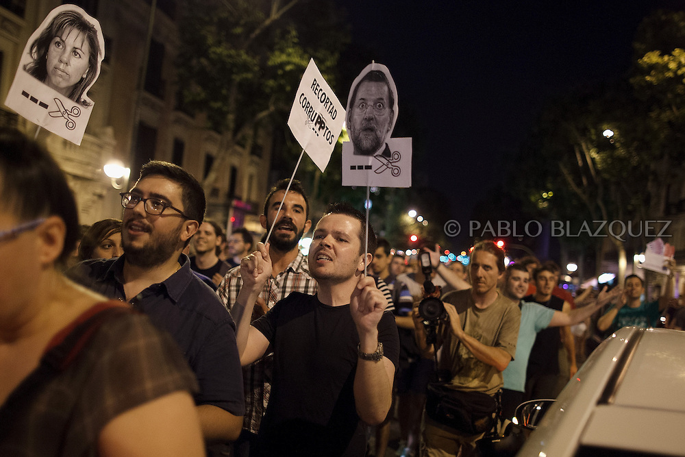 Protestors take the streets during a demonstration against the Spanish government, on Thursday, July 18, 2013, in Madrid, Spain. Thousands demonstrators demanding the resignation of Prime Minister Mariano Rajoy and its party gathered in front of the People's Party headquarter. Rajoy rejected demands to resign after more alleged secret payments and test messages related to former political party treasurer Luis Barcenas under investigation appeared. The spectacle of alleged greed and corruption has enraged Spaniards hurting from austerity and sky high unemployment.