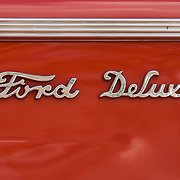 Classic chrome type on the red side of an old Ford.