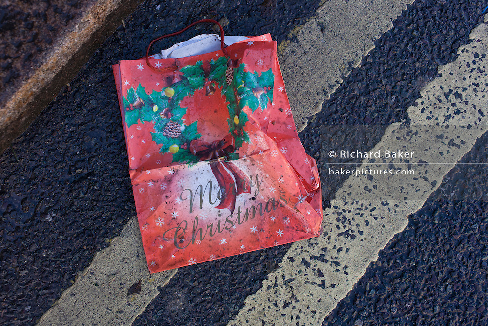A dropped bag with a Merry Christmas message in a south London gutter.