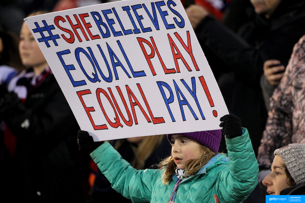 A young fan holding an 'equal pay' banner during the USA Vs Colombia, Women's International friendly football match at the Pratt & Whitney Stadium, East Hartford, Connecticut, USA. 6th April 2016. Photo Tim Clayton