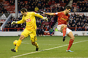 Bolton Wanderers goalkeeper Paul Rachubka wins the ball ahead of Nottingham Forest striker Nelson Castro Oliveira during the Sky Bet Championship match between Nottingham Forest and Bolton Wanderers at the City Ground, Nottingham, England on 16 January 2016. Photo by Alan Franklin.