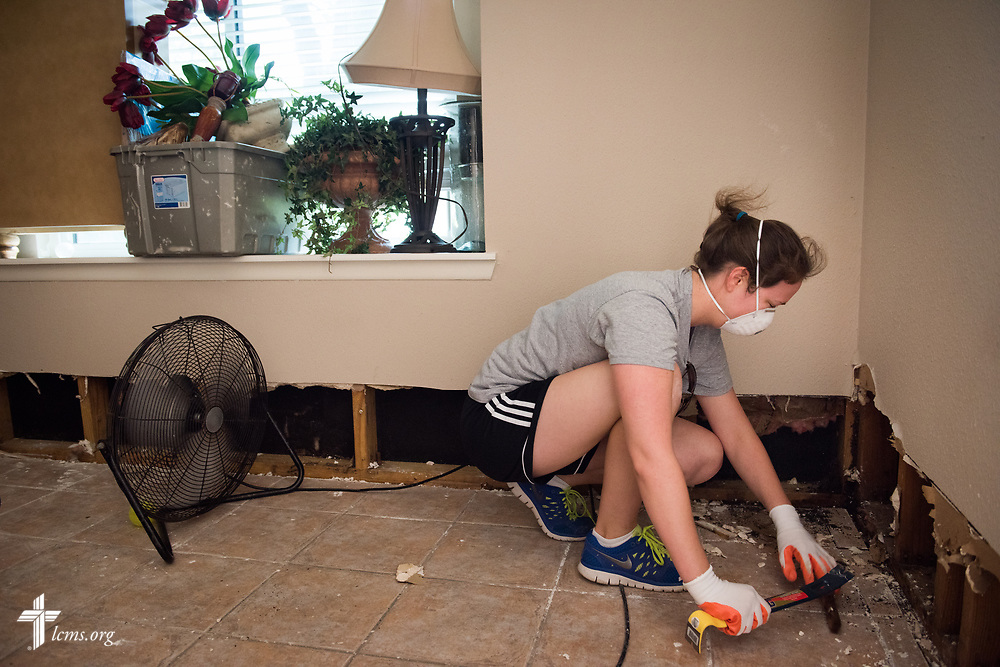 Alyce Lagrone, a member at Memorial Lutheran Church, Katy, Texas, volunteers as she removes flood-damaged baseboards from a home damaged by Hurricane Harvey on Friday, Sept. 1, 2017, in Texas. LCMS Communications/Erik M. Lunsford