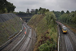 © Licensed to London News Pictures. 16/09/2016. Watford, UK. A landslide can be seen at the entrance to a tunnel (L) as another train passes (R) where a train has derailed near Watford, following heavy rainfall over night. Photo credit: Peter Macdiarmid/LNP