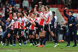 Cheltenham Town players celebrate after the final whistle - Mandatory by-line: Nizaam Jones/JMP - 17/04/2017 - FOOTBALL - LCI Rail Stadium - Cheltenham, England - Cheltenham Town v Grimsby Town - Sky Bet League Two