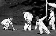 Connor and Cameron Bohn, Mason Palmer, and Lane Wilson play around the green on No. 8 during Wednesday's Par 3 Contest at Augusta National Golf Club, Wednesday, April 6, 2011. They were caddying for their dads, Jason Bohn, Ryan Palmer and Mark Wilson.