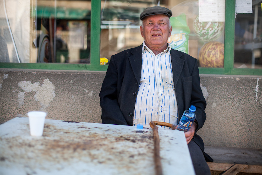 Portrait of a local inhabitent in front of the grocery store in the city of Crnik.