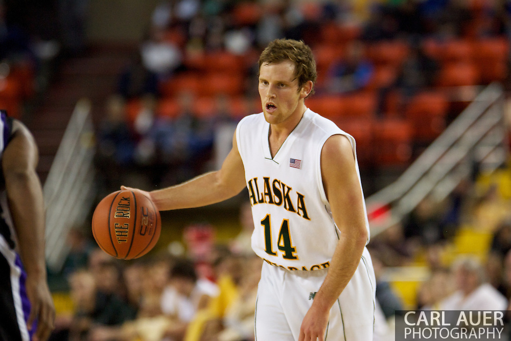 November 25th, 2010:  Anchorage, Alaska - University of Alaska-Anchorage guard Steve White (14) brings the ball up court in the Seawolves 54-86 loss to Weber State in the first round of the Great Alaska Shootout.