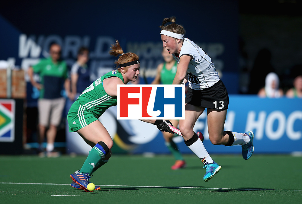 JOHANNESBURG, SOUTH AFRICA - JULY 10:  Zoe Wilson of Ireland and Teresa Martin Pelegrina of Germany battle for possession during day 2 of the FIH Hockey World League Semi Finals Pool A match between Germany and Ireland at Wits University on July 10, 2017 in Johannesburg, South Africa.  (Photo by Jan Kruger/Getty Images for FIH)