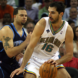 New Orleans Hornets forward Peja Stojakovic #16 drives in on Utah Jazz guard Deron Williams #8 in the second half of their NBA game on April 8, 2008 at the New Orleans Arena in New Orleans, Louisiana. The Utah Jazz defeated the New Orleans Hornets 77-66.