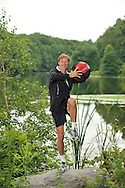 Ralf Hennig, personal trainer,.working out in Rockefeller Preserve State Park with his Performance Ball..