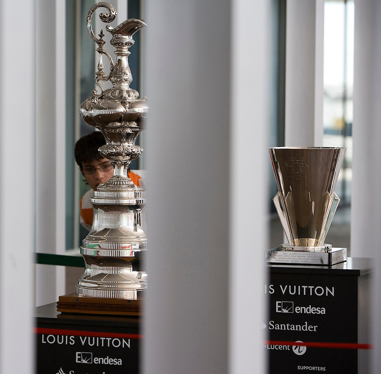 The America's Cup and Louis Vuitton Cup on display at the Foredeck Club, Port America's Cup, Valencia, Spain.