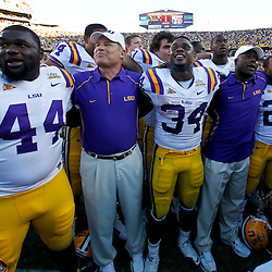 Oct 2, 2010; Baton Rouge, LA, USA; LSU Tigers head coach Les Miles sings  with his players following a win over the Tennessee Volunteers at Tiger Stadium. LSU defeated Tennessee 16-14.  Mandatory Credit: Derick E. Hingle