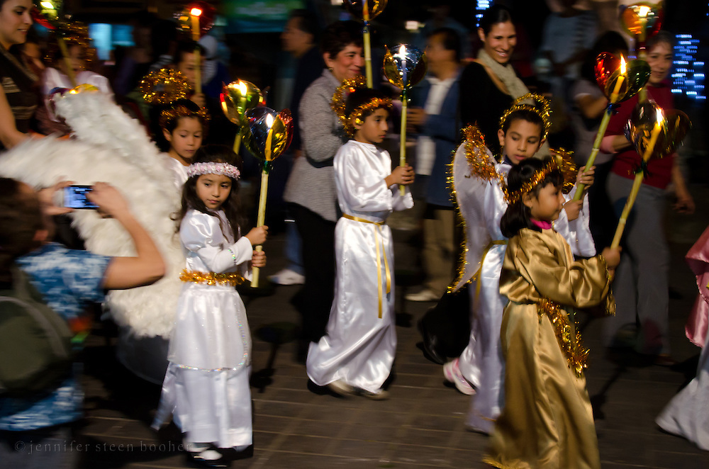 Children dressed as angels in a Christmas Eve posada, Oaxaca, Mexico.