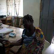 Diana Oja, in labor, arrives at the maternity ward at Kintampo Municipal Hospital. Diana, who is an Oxytocin Initiative participant, was brought to the hospital by CHO Apoyongo McClean from Kawampe village because she was experiencing a prolonged labor.