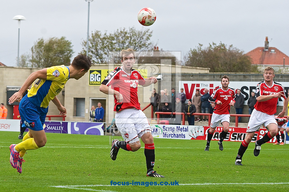 Tom Nichols of Exeter City (left) heads at goal during the Sky Bet League 2 match at the Globe Arena, Morecambe<br /> Picture by Ian Wadkins/Focus Images Ltd +44 7877 568959<br /> 26/10/2014