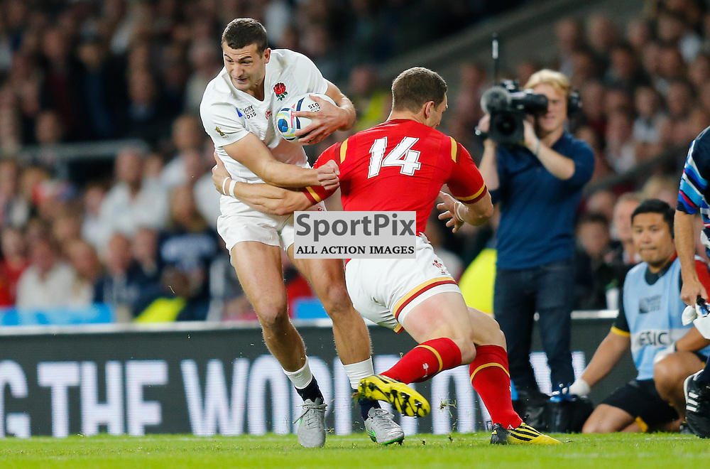 TWICKENHAM, ENGLAND - SEPTEMBER 26: England's winger Jonny May (11) tackled by George North of Wales during the 2015 Rugby World Cup Pool A match between England and Wales at Twickenham Stadium on September 26, 2015 in London, England. (Credit: SAM TODD | SportPix.org.uk)
