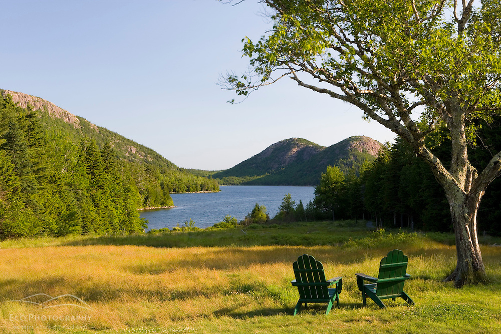 The Adirondack Chairs on the lawn of the Jordan Pond House in Maine's Acadia National Park. Jordan Pond and the Bubbles are in the background.  Mount Desert Island.