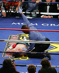 Referee Kenny Bayless takes up the count as Manny Pacquiao knocks out Ricky Hatton in the second round of their Light Welterweight title fight at the MGM Grand, Las Vegas , Nevada, 2nd May 2009.