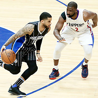 11 January 2017: Orlando Magic guard D.J. Augustin (14) drives past LA Clippers guard Raymond Felton (2) during the LA Clippers 105-96 victory over the Orlando Magic, at the Staples Center, Los Angeles, California, USA.