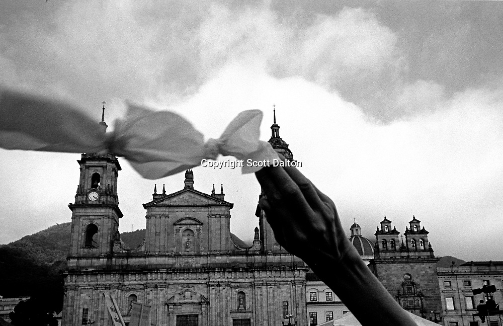 A woman waves a white handkerchief during a peace rally in downtown Bogotá. (Photo/Scott Dalton)