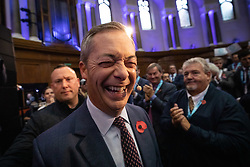 © Licensed to London News Pictures. 04/11/2019. London, UK. Brexit Party leader Nigel Farage leaves the Emmanuel Centre after introducing 600 Prospective Parliamentary Candidates (PPC) standing for the Brexit Party ahead of the upcoming General Election. Photo credit : Tom Nicholson/LNP