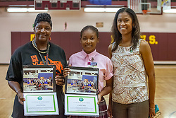 Jennifer Matthias and D'Shanee Blake receive certificates for their participation in the Emerald Gems Foundation, Inc. Basketball & Education Enrichment Program 2016 Minnesota Twin Cities Trip from wife and co-founder Shalaun Newton.  Milt Newton speaks to high school students at Ivanna Eudora Kean High School sharing details about growing up in the Virgin Islands and encouraging students to have hope and focus in pursuing their dreams.  St. Thomas, VI.  27 May 2016.  © Aisha-Zakiya Boyd
