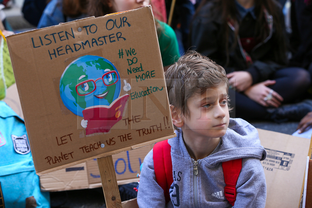 © Licensed to London News Pictures. 22/02/2019. London, UK. A class of young people sitting outside the Department for Education waiting patiently for their lesson on the truth about the climate crisis. Young people, teachers and parents protest to demand that the climate and ecological crisis is acknowledged as an educational priority and that students are taught the truth about the world they are inheriting. Photo credit: Dinendra Haria/LNP