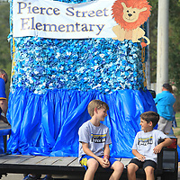 John Austin Wood and Brother Grubbs, both 10 and fourth graders at Pierce Street Elementary School, sit a wait on their schools float for the Homecoming parade to get started Thursday afternoon in downtown Tupelo.