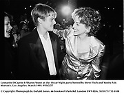 Leonardo DiCaprio & Sharon Stone at the  Oscar Night party hosted by Steve Tisch and Vanity Fair. Morton's. Los Angeles. March 1995. 95542/27<br />