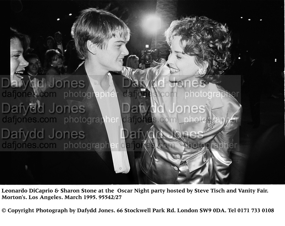 Leonardo DiCaprio &amp; Sharon Stone at the  Oscar Night party hosted by Steve Tisch and Vanity Fair. Morton's. Los Angeles. March 1995. 95542/27<br />