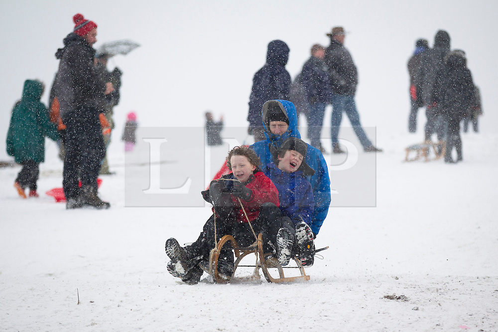 © Licensed to London News Pictures. 20/01/2013. London, UK. Londoners take advantage of a snowy Sunday to sledge down Parliament Hill in Hampstead Heath, London, today 20/01/13) as the capital experienced its third day of heavy snowfall. Photo credit: Matt Cetti-Roberts/LNP