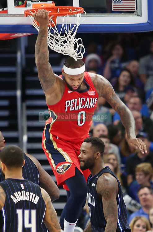 December 22, 2017 - Orlando, FL, USA - The New Orleans Pelicans' DeMarcus Cousins (0) hangs from the rim during action against the Orlando Magic at the Amway Center in Orlando, Fla., on Friday, Dec. 22, 2017. (Credit Image: © Stephen M. Dowell/TNS via ZUMA Wire)
