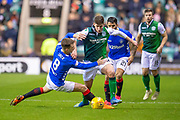 Ryan Jack (#8) of Rangers FC tackles Emerson Hyndman (#20 ) of Hibernian FC during the Ladbrokes Scottish Premiership match between Hibernian and Rangers at Easter Road, Edinburgh, Scotland on 19 December 2018.