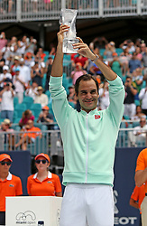 Roger Federer, of Switzerland, poses with the trophy after defeating John Isner, of the United States, 6-1, 6-4 during the final of the Miami Open tennis tournament at Hard Rock Stadium on Sunday, March 31, 2019, in Miami Gardens, Fla. Roger Federer won 6-1, 6-4. Photo by David Santiago/Miami Herald/TNS/ABACARESS.COM