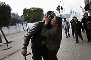 A protester kisses a policeman during a  demonstration in the center of Tunis .People still protest against the partecipation of the Constitutional Democratic Rally, RCD, party of Ben Ali, to the national unity government ...On 17 december Mohamed Bouazizi a fruit seller form the city of Sidibouzid in Tunisia set fire to himself starting a wave of protest that will change several arab countries under the name of Arab Spring..Despite the dictator Zine El-Abidine Ben Ali left the country on 14 January after weeks of protest the demonstrations continue asking for the political party of the regime (RCD) and all the political men involved on the past government where banned from the political life ..