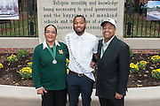 Ohio University President, Roderick McDavis, and Ohio University First Lady, Deborah McDavis, pose with Jamison Days, a member of Ohio University's Homecoming Court, at the College Gateway on October 8, 2016.